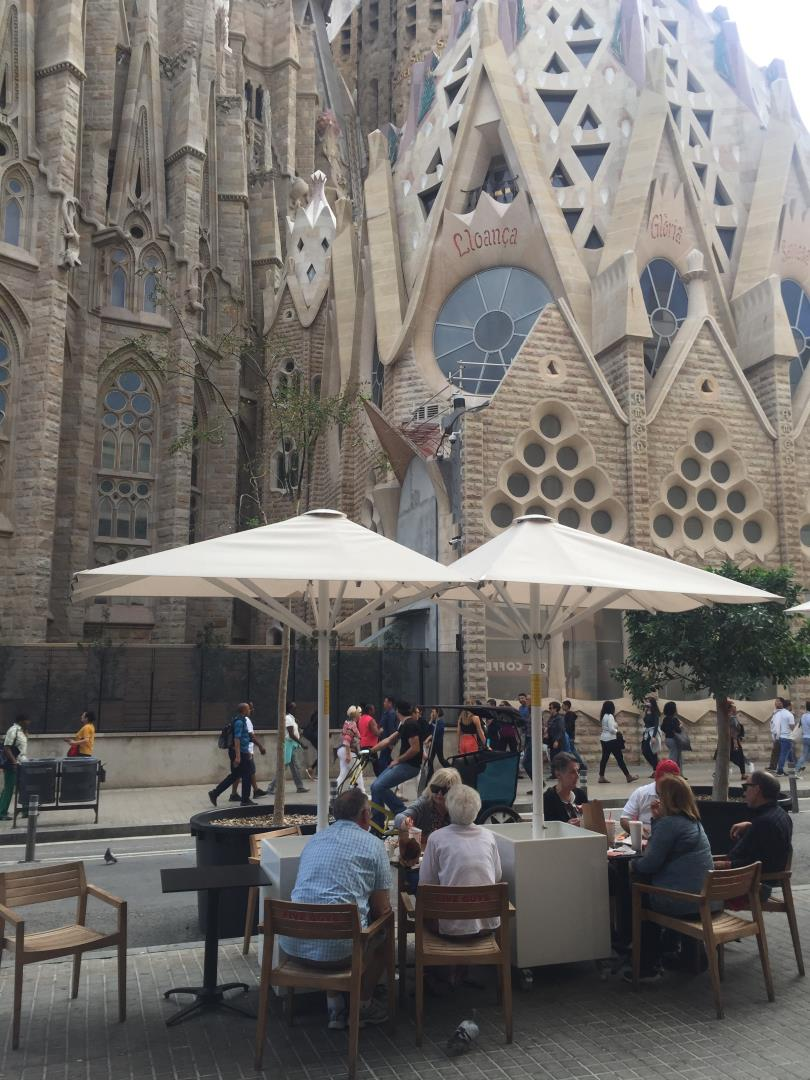 Snelgrove Travel Agents having lunch in shadows of Sagrada Familia Cathedral Barcelona